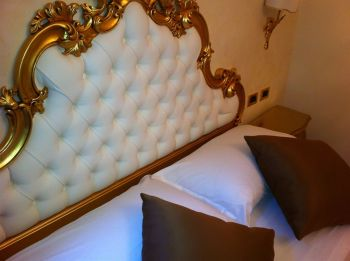 Always at least one golden piece in every room - ours was the headboard