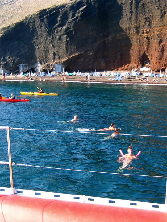 Swimming off the side of the catamaran at the red beach