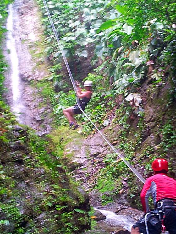 Rappelling down a waterfall